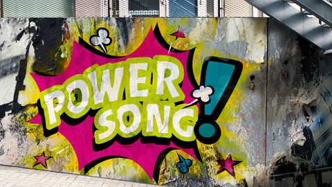 "Knalliges Graffiti auf Mauer mit Text ""hr1-Powersong"""