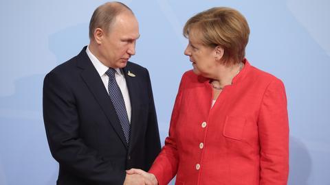 Putin und Merkel