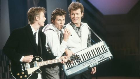 Pål Waaktaar-Savoy, Morten Harket und Magne Furuholmen von a-ha bei einem Konzert 1988